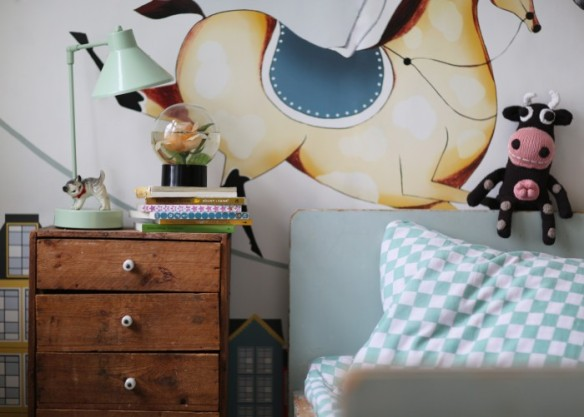 Interior design for kids room showing a blend of vintage, new and handmade  cow from yawama of sweden